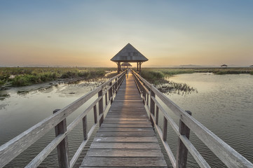 walkway on the lake to pavilion at sunset, Sam Roi Yod National Park, Prachuap Khiri Khan, Thailand