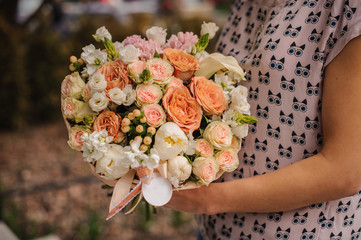 Bouquet of the different  orange flowers in hands