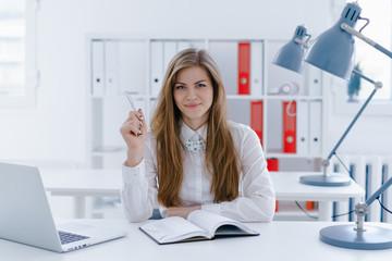Woman making journal entries
