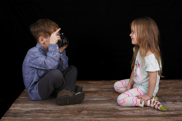 Boy taking photo of his sister