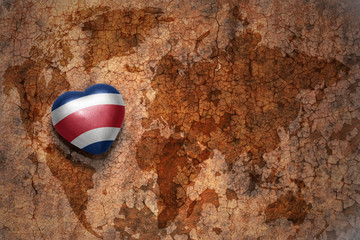 heart with national flag of costa rica on a vintage world map crack paper background. concept