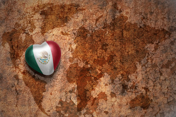 heart with national flag of mexico on a vintage world map crack paper background. concept