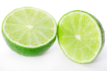 Two limes sliced isolated on white clipping path