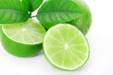 Limes sliced isolated on white clipping path