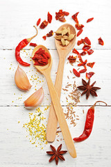 Various of spices on wooden background