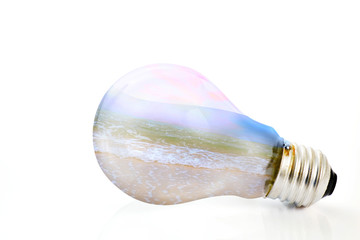 Light bulb / Light bulb with beach on white background. Nature concept.