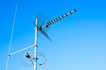 simple antenna mast with antennas to receive digital TV and radi