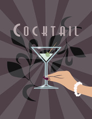 Female hand holding Martini cocktail