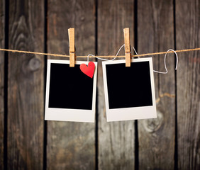Blank instant photos and small red paper heart