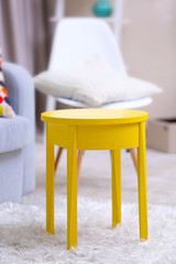 Vivid home interior with yellow coffee table and decorations