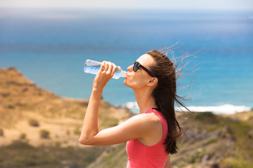 Fit female drinking water.