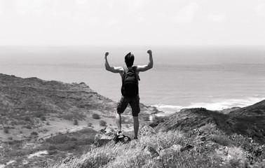 Fit male hiker celebrating.
