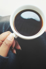 Selfie of hand with coffee cup