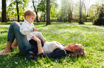 Mother and son playing together in a park