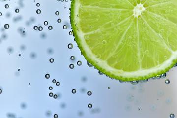Sliced Thai lime dip in soda water