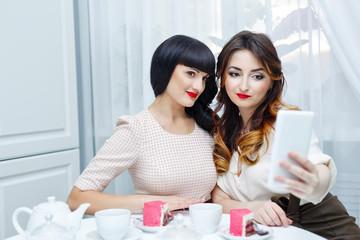 Friends doing selfie. Tea party.