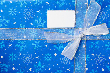blue christmas gift box with placard.