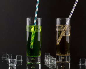 Set from two a collins glass with soda and colored straws.