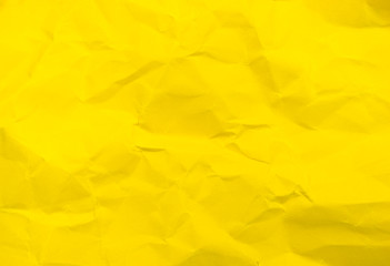 Vivid yellow color crumpled paper texture background