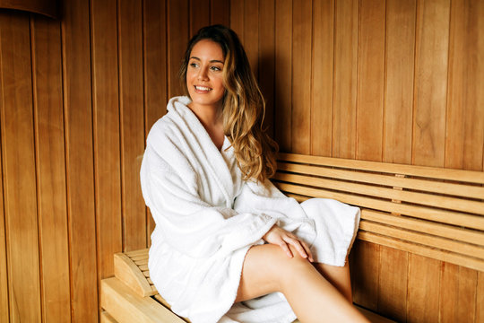 Beautiful woman relaxing in sauna