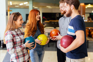 Friends enjoying bowling at club