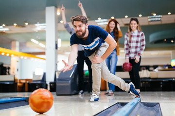 Friends bowling at club