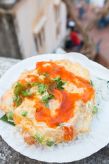 Rice omelet with chili sauce