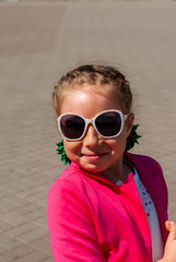portrait of a little girl in sunglasses sunny summer day for a walk