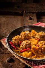 Traditional Tajine Dish of Yellow Curry Meatballs