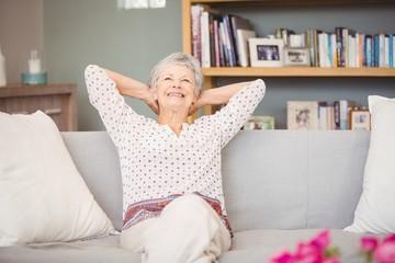 Senior woman relaxing on sofa