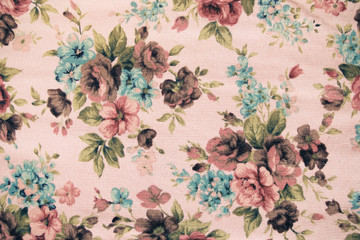 Fragment of colorful retro tapestry textile pattern with floral
