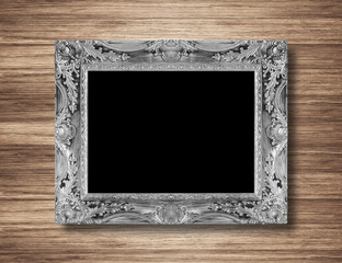 antique silver frame on wood wall background