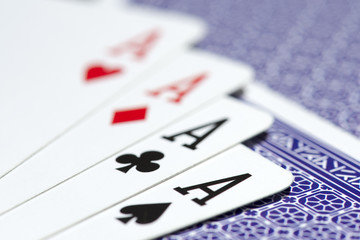 close up of four aces on a deck of cards