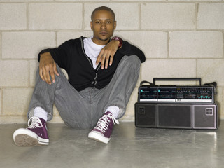 hip hop african man sitting beside his stereo