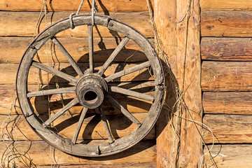 decorative wheel hanging on a Russian log hut