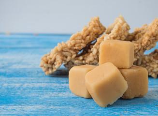 Coconut sugar , Cube sugar , Rice Crackers on Blue background.
