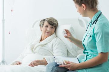 Nurse giving medcines to patient