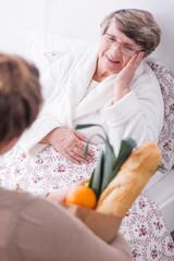 Woman visiting ill senior
