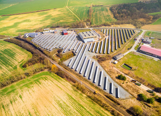 Aerial view to solar power plant in agricultural landscape. Industrial background on renewable resources theme.