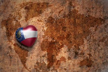 heart with georgia state flag  on a vintage world map crack paper background