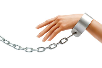 Woman's hand in chains isolated on white background. Close up, concept against violence