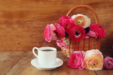 image of beautiful flowers next to cup of coffee
