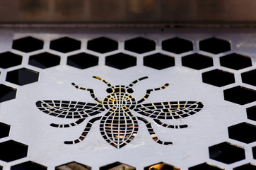 Metal bee ashtray in Manchester.