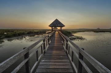 walkway on the lake to pavilion at sunset, Sam Roi Yod National Park, Prachuap Khiri Khan, Thailand with low key light