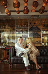 Older Caucasian couple relaxing in lounge