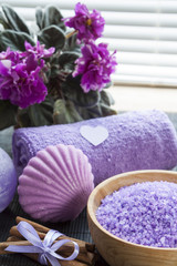 Lavender bath salts with flowers, cinnamon, soap and towel
