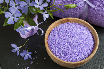 Lavender bath salts with flowers and towel