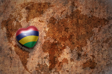 heart with national flag of mauritius on a vintage world map crack paper background.
