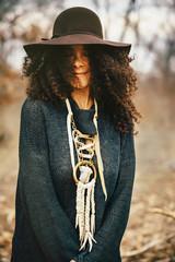 Mixed race woman wearing stylish sweater and hat