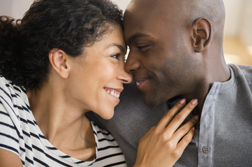 Close up of smiling couple rubbing noses